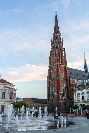 OSIJEK, CROATIA - JUNE 4, 2016: Osijek Catholic Cathedral, the Church of St Peter & Paul, also called osjecka konkatedrala svetog petra i pavla, seen from the main square, Ante Starcevic.Panorama of the city center of Osijek, seen from its main square,