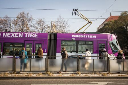 PRAGUE, CZECHIA - OCTOBER 31, 2019: Prague tram, or called Prazske tramvaje, Skoda 14 T model, on line 3, crowded with commuters. Managed by DPP, it's a public transporation network.Picture of a Skoda 14 T tram ready for departure with commuters on the  Sajtókép