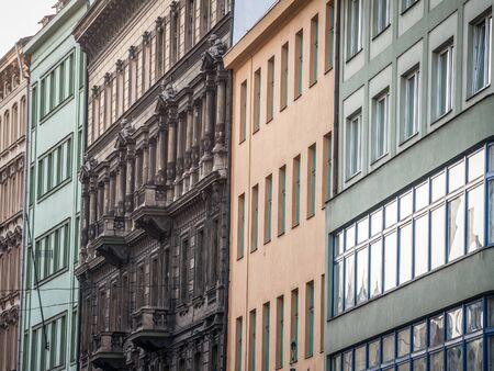 Facade of Old residential buildings from the 1930's in the city center of Prague, Czech Republic, used for accomodation on the real estate market.Picture of old Czech buildings in Prague, Czech Republic, used for residential and accommodation purposes in the city center.