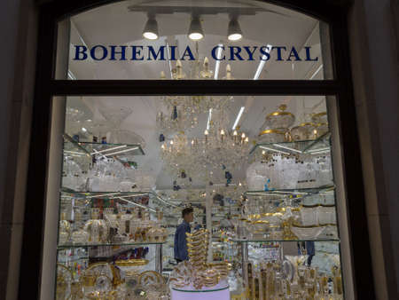 PRAGUE, CZECHIA - NOVEMBER 3, 2019: Facade of a Souvenir shop in Prague selling Bohemia Crystal. Bohemian crystal and glass is one of the main crafts of Czech Republic.Picture of a Prague souvenir shop at night in the Old town, specialized in Bohemian c