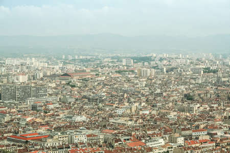 Aerial view of Marseille, with a focus on Belsunce and Saint Charles, districts with a high urban density, during a polluted day.