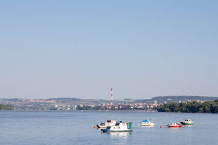 Zemun Quay (Zemunski Kej) in Belgrade, Serbia, on the Danube river, seen in summer. Boats can be seen in front, and Belgrade center in background. 스톡 콘텐츠