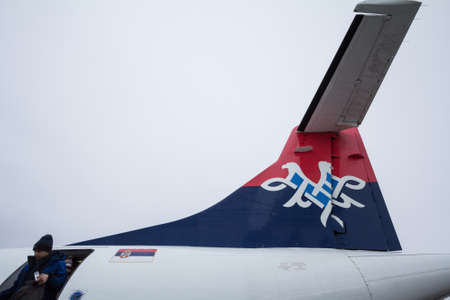BELGRADE, SERBIA - FEBRUARY 11, 2020: Passengers boarding out of a ATR 72 aircraft with the Logo of the flag airline carrier of Serbia, Air Serbia.