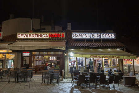 SARAJEVO, BOSNIA - APRIl 15, 2017: Cevabdzinica and Doner Kebab Fast Foods next to each other in Bascarsija. Editorial