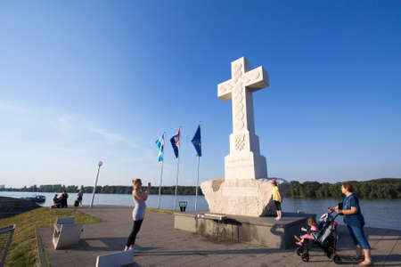 VUKOVAR, CROATIA - MAY 11, 2018: people taking pictures in front of the White Cross, or Bijeli Spomen Kriz, a memorial from the catholic church to people who died during the 1991 1995 Serbia Croatia conflict. Editorial