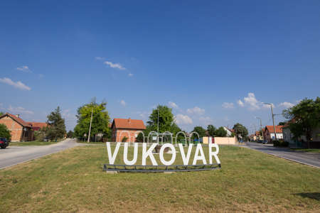 VUKOVAR, CROATIA, MAY 11, 2018: Vukovar sign at a road and street at the entrance of the city during a summer afternoon. It is a city on Slavonija, in Eastern Croatia.