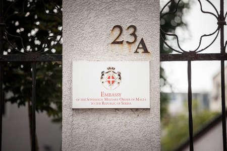 BELGRADE, SERBIA - SEPTEMBER 3, 2018: Sign indicating the Order of Malta embassy of Belgrade. 에디토리얼