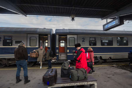 BUCHAREST, ROMANIA - FEBRUARY 15, 2020: Passengers unboarding an intercity train from CFR Calatori, the romanian railways company, in Gara de Nord, the main railway station of Bucharest.