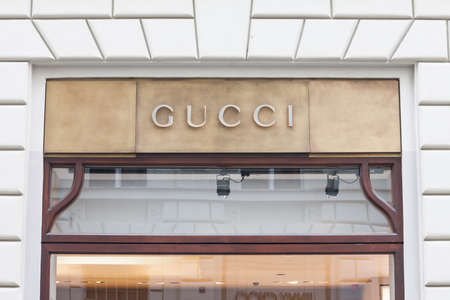 PRAGUE, CZECHIA - NOVEMBER 1, 2019: Gucci logo in front of their main boutique for Prague. Gucci is a luxury fashion designer, manufacturer and retailer from Italy. Picture of a sign with the logo of Gucci taken on their main store for Prague, Czech Repub
