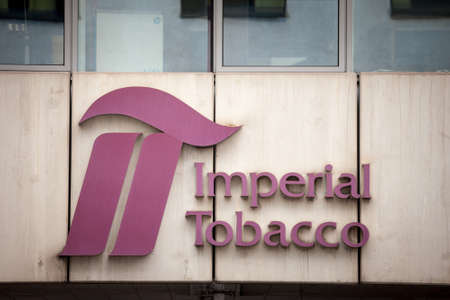 PRAGUE, CZECHIA - OCTOBER 31, 2019: Imperial tobacco logo in front of their office in Prague.
