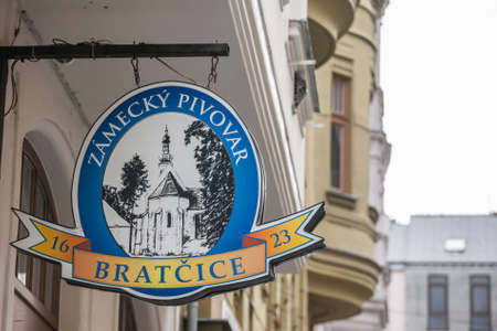 PRAGUE, CZECHIA - NOVEMBER 5, 2019: Bratcice Pivo logo in front of a local retailer bar in Prague.