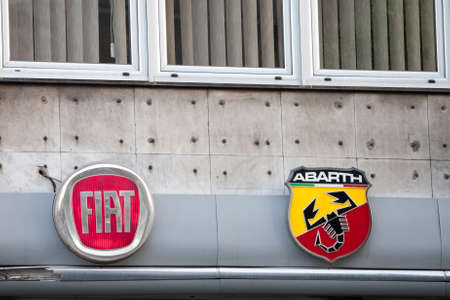 BELGRADE, SERBIA - MAY 8, 2020: Fiat and Abarth logos in front of their car dealership for Belgrade.