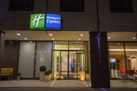BELGRADE, SERBIA - SEPTEMBER 23, 2018: Holiday Inn Express logo on a sign in front of their main hotel in Serbia.