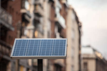 Small individual solar panel in a street, in an urban environment, used for electricity and power generation using the sun energy.
