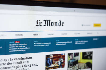 PARIS, FRANCE - APRIL 11, 2021: Selective blur on the logo of Le Monde on their digital version, the lemonde.fr website. Le Monde is a French newspaper, a reference of French press. Picture of a screen with the logo of Le Monde on display on a computer in