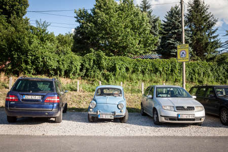 BELGRADE, SERBIA - JUNE 23, 2018: Old Zastava 750, blue color, in poor condition, parked on a parking next to more modern cars. Zastava 750, or Fica, was a supermini car from Yugoslavia in the 60s.