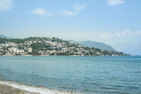 Panorama of the main hill of Herceg Novi, seen from a beach on the Igalo resort, on the Adriatic Sea. Herceg Novi is a major touristic destination. Imagens