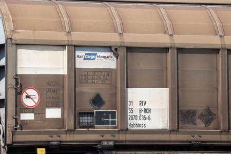 LJUBLJANA, SLOVENIA - JUNE 17, 2021: Logo of Rail Cargo Hungaryon a freight wago on a cargo train. Part of Rail Cargo Austria, it is a rail freight transportation company in Europe. Editorial