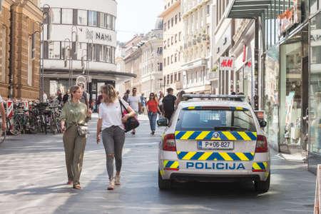 LJUBLJANA, SLOVENIA - JUNE 14, 2021: Slovenian police car standing in a pedestrian way while patrolling. Policija Slovenia, or police of slovenia, is the main law enforcement force in Slovenia.