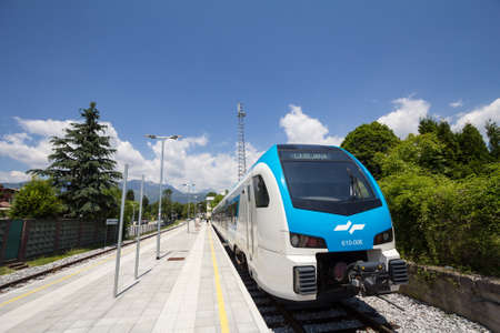 KAMNIK, SLOVENIA - JUNE 16, 2021: Slovenian Railways (Slovenske Zeleznice) DMU Diesel multiple unit, a Stadler Flirt desiro Series 610 on Kamnik train station platform.