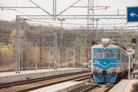 RESNIK, SERBIA - APRIL 10, 2021: Electric suburban train, an EMU of Beovoz BG Voz service entering Resnik train station platform in the suburbs of belgrade.