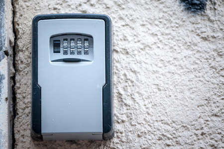 Lockbox, also called keysafe, or key safe, in front of the entrance door of a short term vacation rental, made at delivering keys to guests without contacts. Imagens