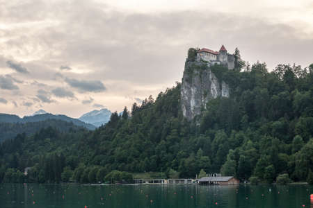 Selective blur on the Bled castle, also called Blejski Hrad, during summer, at sunset, by the mountains of Julian alps. Bled Castle is a major monument of Slovenia.