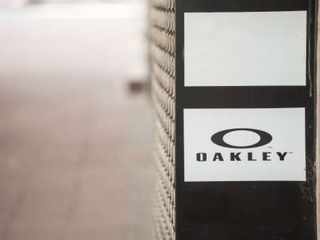 BELGRADE, SERBIA - MAY 30, 2021: Selective blur on an Oaxley logo in front of their local retailer for belgrade. Oaxley is an American manufacturer of sunglasses and sports equipment.