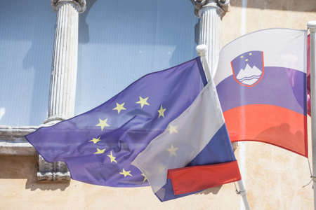Flags of the European Union and Slovenia waiving together in the Slovenian capital city, Ljubljana. Slovenia is a member of the EU since 2004 and a major actor of the European game.