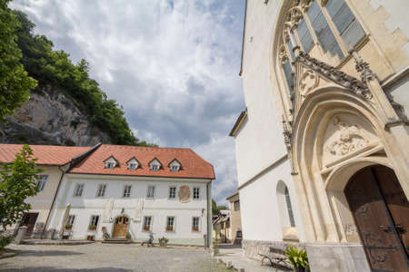 BLED, SLOVENIA - JUNE 12, 2021: Old Parish house, or stari Farovz, next to Saint Martin church, or Cerkev Svetog Martina. it's a catholic church and monument of Slovenia, by the Bled lake, or blejsko jezero. Editorial