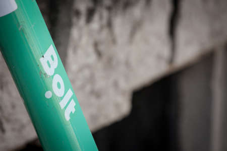 ZAGREB, CROATIA - JUNE 18, 2021: Bolt logo on an electric scooter to rent in Zagreb. Bold is an Estonian tech company specialized in vehicle sharing and food delivery spread in Europe.