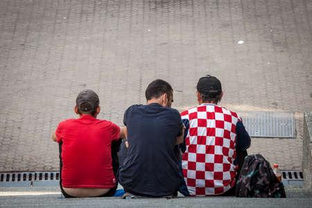 ZAGREB, CROATIA - JUNE 19 2021: Men, football supporters, wearing Football Soccer jersey t-shirts, from the Croatian Football team, or HNS, Hrvatska Nogometni sais, during Euro 2020 UEFA championship.