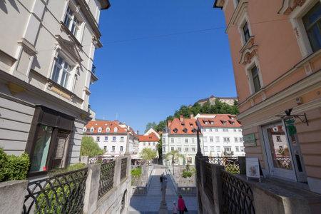 LJUBLJANA, SLOVENIA - JUNE 14, 2021: Panorama of Ljubljanica river seen from the ribja brv, the fishmarket bridge, with ljubljana castle visible in background, in the city center of Ljubljana. Editorial
