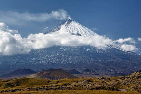 stratovolcano: Kliuchevskoi Volcano Klyuchevskaya Sopka is a stratovolcano the highest mountain on the Kamchatka Peninsula of Russia the highest active volcano of Eurasia. Stock Photo