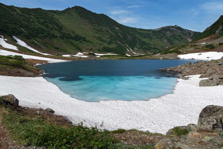 Beautiful mountain landscape: Blue Lake a comprehensive natural heritage of Kamchatka Peninsula Russia Far East on a sunny day photo