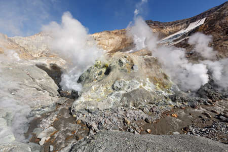 Volcanic landscape of Kamchatka: brimstone and fumarole field in crater of active Mutnovsky Volcano. Russia Far East Kamchatka Peninsula photo