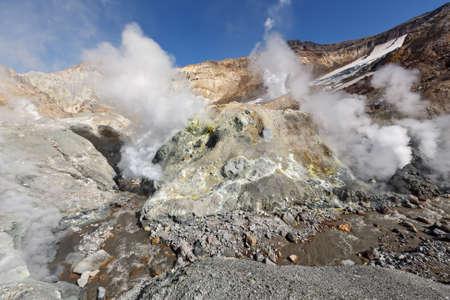 fumarole: Volcanic landscape of Kamchatka: brimstone and fumarole field in crater of active Mutnovsky Volcano. Russia Far East Kamchatka Peninsula Stock Photo