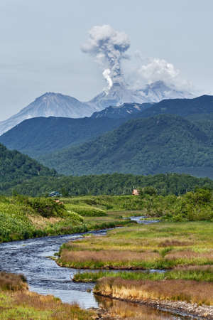 Beautiful mountain landscape: view of eruption active Zhupanovsky Volcano on Kamchatka Peninsula Russia Far East.