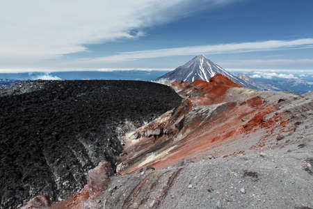 slag: Summer volcanic landscape: beautiful view of active crater Avacha Volcano on Kamchatka Peninsula on background Koryaksky Volcano in sunny weather. Far East Russia Kamchatka. Stock Photo