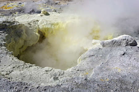 steam mouth: Nature of Kamchatka: sulfur fumarole in crater active Mutnovsky Volcano. Russia Far East Kamchatka Peninsula.