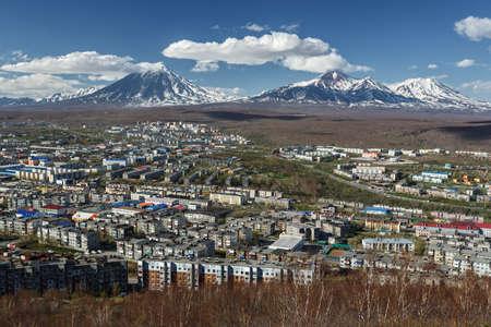 Panoramic view of the city PetropavlovskKamchatsky and volcanoes: Koryaksky Volcano Avacha Volcano Kozelsky Volcano. Far East Russia Kamchatka Peninsula.