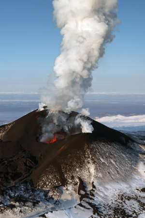 effusion: Beautiful nature of Kamchatka: eruption Tolbachik Volcano effusion from the crater lava gas steam ash. Russia Far East Kamchatka Peninsula. Stock Photo