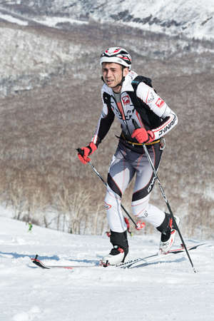 mountaineering: MOUNTAIN MOROZNAYA, ELIZOVO, KAMCHATKA, RUSSIA - APRIL 25, 2014: Vertical race. Ski mountaineering Asian Championships, Ski mountaineering Russian Championship, International competitions ISMF series Kamchatka Race, Ski mountaineering Kamchatka Championsh