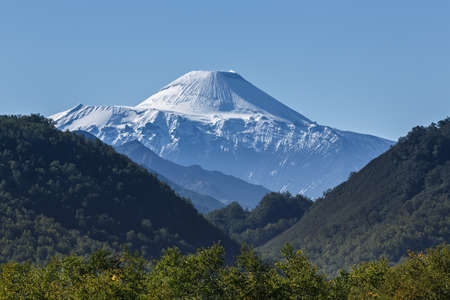 the far east: Nature of Kamchatka Peninsula: beautiful summer landscape - view on active Avachinsky Volcano on a sunny day. Russia, Far East.