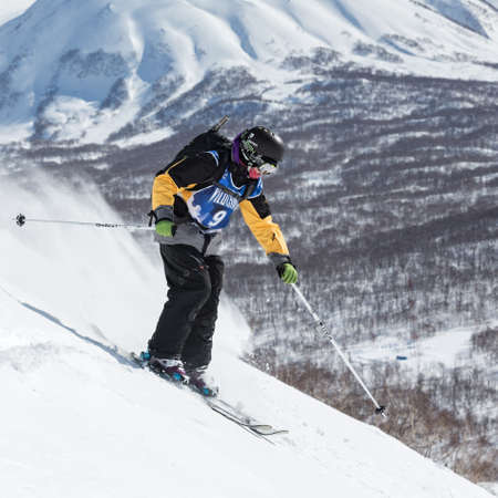far east: KAMCHATKA, RUSSIA - MARCH 9, 2014: Skier rides steep mountains. Competitions freeride skiers and snowboarders Kamchatka Freeride Open Cup. Far East, Russia, Kamchatka Peninsula.