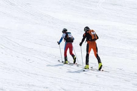 KORYAK, AVACHA VOLCANOES, KAMCHATKA, RUSSIA - APRIL 27, 2014: Team ski mountaineers climb the mountain on skis. Team Race ski mountaineering Asian, ISMF, Russian and Kamchatka Championship. Редакционное