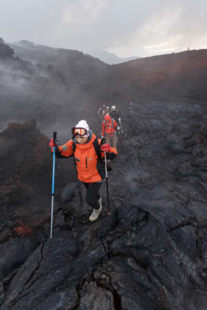 lava field: KAMCHATKA, RUSSIA - JULY 27, 2013: Group of tourists hiking on the new lava field eruption Tolbachik Volcano on Kamchatka Peninsula. Russia, Far East.
