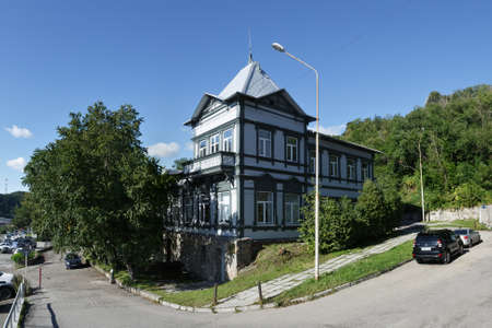 unified: PETROPAVLOVSK-KAMCHATSKY, KAMCHATKA, RUSSIA - SEPTEMBER 7, 2015: View of the old wooden building of the Kamchatka regional unified museum in Petropavlovsk-Kamchatsky City on Kamchatka Peninsula. Editorial
