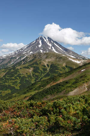 far east: Beautiful mountain landscape on Kamchatka Peninsula: picturesque view of Viliuchinsky Volcano at sunny day. Photo stratovolcano photographed with Vilyuchinsky pass Kamchatka, Far East, Russia.