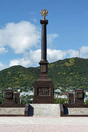 townscape: PETROPAVLOVSK-KAMCHATSKY, KAMCHATKA, RUSSIA - SEP 07, 2015: Scenic view of the stela City of Military Glory on the Petropavlovsk-Kamchatsky City on a sunny day. Russia, Far East.